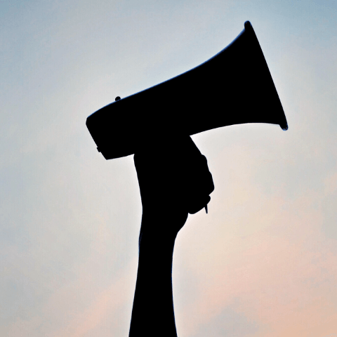 megaphone-silhouette-against-a-pink-and-blue-sky-